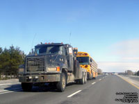Trucks tows a School bus